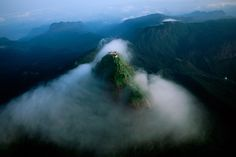Book a Tour to Sri Lanka, a beautiful island country with amazing locations to explore. We have a list of places you would surely love. Book a Sri Lanka Tour! Adam's Peak Sri Lanka, Le Sri Lanka, Lonely Planet, Beautiful Islands, Beautiful Places, Beautiful Scenery, National Geographic Wallpaper, Wallpaper Free, Sacred Mountain