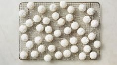 Rolling these classic Christmas cookies in powdered sugar once while they're still warm and again when they're completely cooled ensures their snowball-like appearance.