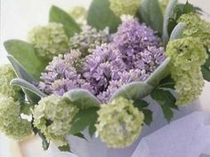 A beautifully subtle and understated colour combination for a wedding bouquet. The foamy green /white heads of the Opulous have been coordinated with similarly subtle grey green of the succulent leaves and the Lilac Hyacinth blooms.
