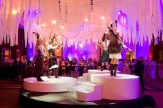 As guests entered the front area of the reception, they encountered Urban Electra, an electric string quartet outfitted in on-theme, leather-accented costumes playing atop a multilevel circular stage. Photo: Courtesy of Experient