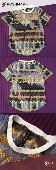 W118 By WALTER BAKER Florentina Short Sleeve Top W118 by Walter Baker. Size: XS. Blue and gold patterned fabric. Short sleeves. Light, sturdy material. Tiny unnoticeable spots on back of neck collar, can easily be removed with dry cleaning. Work only a handful of times, and in otherwise wonderful condition! W118 by Walter Baker Tops