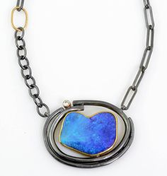 Centro Opal Necklace; Boulder opal, 10pt. diamond, oxidized silver, 18k & 22k gold. Pendant is 1 1/4 x 1 5/8 inches wide. $3,570 - Sydney Lynch Jewelry