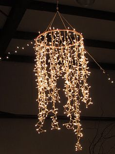 hula hoop chandelier...want to do this for the outsoor family BBQ area...looks pretty easy to pull off