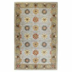 Hand-tufted wool rug with floral motif.  Product: RugConstruction Material: 100% WoolColor: SlateFeatures: Hand-tuftedNote: Please be aware that actual colors may vary from those shown on your screen. Accent rugs may also not show the entire pattern that the corresponding area rugs have.Cleaning and Care: Regular vacuuming and spot cleaning recommended