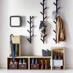 Avoid entryway clutter with open storage boxes for shoes and racks for hats and . Avoid entryway clutter with open storage boxes for shoes and racks for hats and jackets.