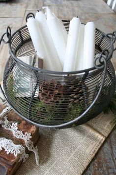 lovely wire basket filled with white candles