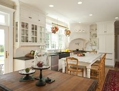 White cabinets, dark counters, black sink, wood floor ... Love the glass front cabinets