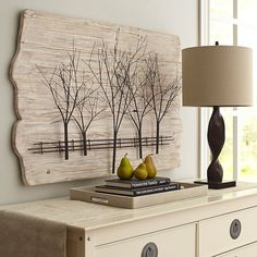 Longing for the sight of something more woodsy and rustic around your home? Hang this painted ivory fir and sculpted metal panel in the den, dining or bedroom, and suddenly the landscape changes in your favor. The 3-D effect and airy tree and fence motif bring a bit of the outside, indoors. Beautifully.