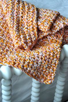 beautiful baby afghan crocheted in single stitch with 3 strands together... free tutorial at aesthetic nest