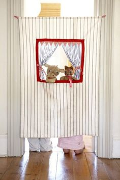 Puppet Show theater in the doorway. (Though I think instead of thumbtacks I'd use a spring tension rod to hold it up....no holes in door frames.)