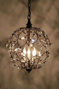 """Lambent Sphere Chandelier I'm not a big fan of the whole """"a chandelier in every room"""" movement (in the bathroom? a chandelier?) - too formal and forced for me. Home Lighting, Chandelier Lighting, Pendant Chandelier, Round Chandelier, Hanging Chandelier, Simple Chandelier, Small Chandeliers, Modern Lighting, Lighting Ideas"""