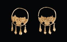 Pair of earrings depicting griffin heads and the face of the god Bes. Gold. Phoenician, ca. 9th-6th century B.C.
