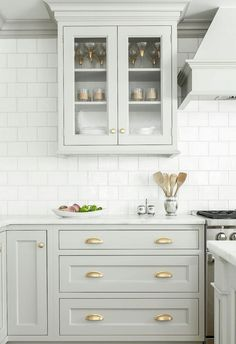 Looking for some grey and gold kitchen inspiration? Here's a sneak peek at our grey and gold kitchen renovation + the images that inspired me! Two Tone Kitchen Cabinets, Kitchen Cabinet Design, Kitchen Redo, Interior Design Kitchen, New Kitchen, Kitchen Ideas, Kitchen Cabinetry, Kitchen Backsplash, Backsplash Ideas