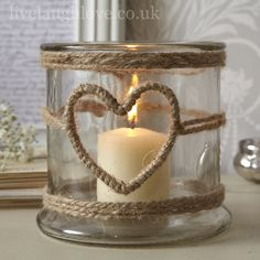 1001 Ideas for Summer DIYs to Brighten Up Your Home summer crafts big jar decorated with burlap ropes with heart-shape detail containing one lit candle The post 1001 Ideas for Summer DIYs to Brighten Up Your Home appeared first on Summer Diy. Pot Mason Diy, Mason Jars, Mason Jar Crafts, Bottle Crafts, Candle Jars, Mason Jar Candle Holders, Yankee Candle, Candle Sticks, Candleholders