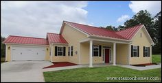Handicap accessible home at 1793 Sq Ft with 3 bedrooms, 2 bathrooms. A modern red metal roof and traditional white columns add personality.