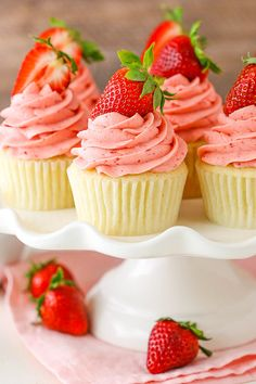 Strawberries and Cream Cupcakes - moist vanilla cupcakes, fresh cream with chopped strawberries and strawberry frosting!