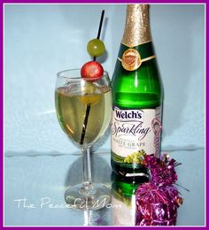 Kid Friendly New Year's Drink-  Serve sparkling white grape juice in wine or champagne glasses. Place fruit on a coffee stirrer for fun decoration. You can even add a little 2012 banner to the stirrer.