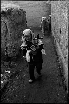 CHINA. Shanxi Province. 1996. Duan Yuxin, 82, has suffered from mental illness for more than 60 years. During spells of her illness her main symptom was to walk around the village day and night, loudly reciting Bible verses. From 1966 to 1976, the ten-year period when religion was prohibited, she was the only one who could openly recite Bible verses. Because she was a madwoman, the government was unable to make her stop. On many nights during the time of religious suppression, believers…