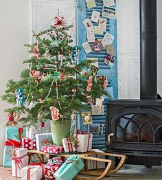Utilize a Small Space A cozy arrangement can set the stage for your entire living room, and it's a great way to show off your favorite vintage pieces. Display cards on an antique shutter or door, and add height to a teeny Christmas tree with an old toboggan.