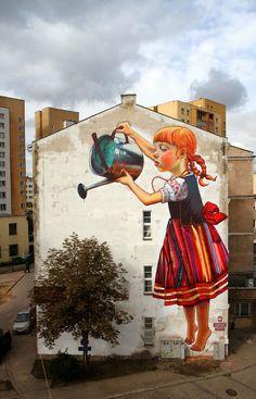 Building-Sized Street Art Portraits by Natalia Rak. Girl watering a tree