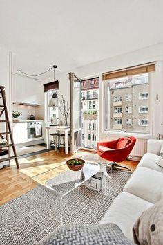 salon avec une table basse en verre, meubler son appartement, idee amenagement interieur