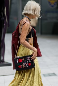 If you're still unconvinced by the inescapable velvet trend, here's more proof that you won't end up looking like a set of curtains. #refinery29 http://www.refinery29.uk/2016/10/126995/street-style-seoul-fashion-week#slide-6