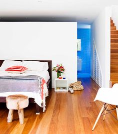 1950's renovated house in Sydney, Australia.  sundrenched beach cottage, with open air walls lotta white, but has warm comfortable furnishings