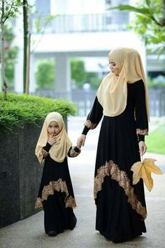 Abaya is a long loose dress. Women wear abaya when they go outside home. They wear abaya for coverin