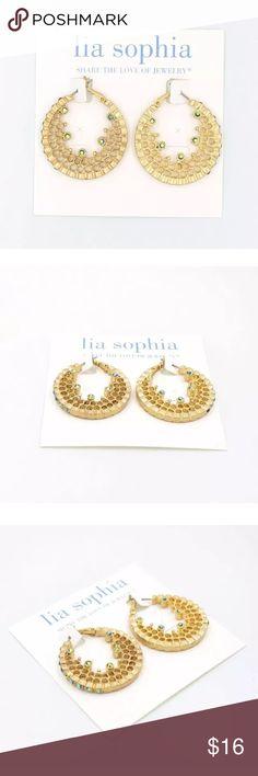 New Lia Sophia open gold crystal earrings New, never worn gorgeous gold hoop like earrings with green crystals. Lia Sophia Jewelry Earrings