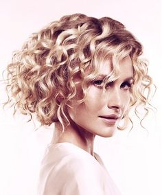 A medium blonde wavy curoly coloured multi-tonal hairstyle by Trevor Sorbie