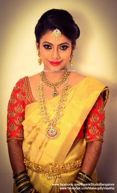 Our bride Charita gives a striking pose after her makeover for her reception. Makeup and hairstyle by Vejetha for Swank Studio. Photo credit: Manish Ananda. Red lips. Statement necklace. Bridal jewelry. Bridal hair. Silk sari. Bridal Saree Blouse Design. Indian Bridal Makeup. Indian Bride. Gold Jewellery. Statement Blouse. Tamil bride. Telugu bride. Kannada bride. Hindu bride. Malayalee bride. Find us at https://www.facebook.com/SwankStudioBangalore