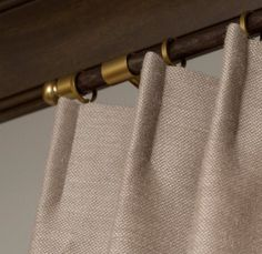 Gold Drapery Hardware adds elegance and style to your room.