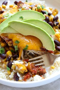 This EASY Slow Cooker Chicken dish is cheesy and delicious, made with boneless chicken breast, black beans, corn and salsa topped with melted cheddar cheese.