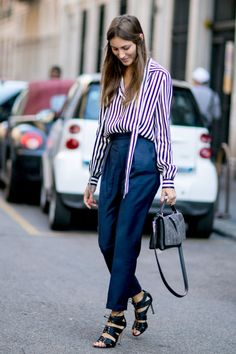 A striped shirt is a must-have for any working woman. Style it with high-waisted trousers and lace-up heels for a little flair.