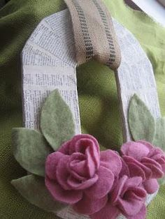 DIY sweetheart wreath with felt flowers and vintage paper