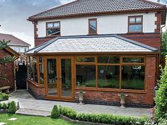 Light Oak conservatory with Guardian Warm Roof Tiled Conservatory Roof, Conservatory Ideas, Warm Roof, Pewter Grey, Light Oak, Sunroom, Home Remodeling, Gazebo, Home And Garden