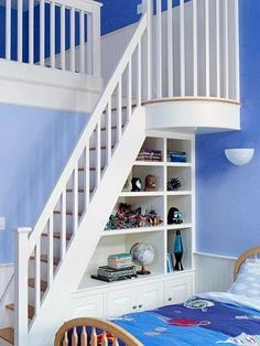 clever under-the-stairs bookshelf nook for kids