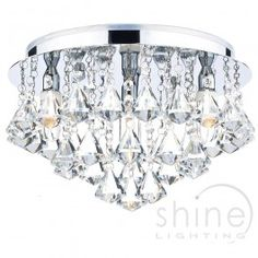 Fringe FRI0450 flush bathroom ceiling light by Dar lighting. Modern flush ceiling light.  Features decorative crystal glass shapes.  Finished in polished chrome.  IP rated so suitable for use in your bathroom.   4 x 25w G9 mains voltage halogen   Height: 20cm   Diam: 35cm   IP rated: IP44 (Zones 1/2) £115.00