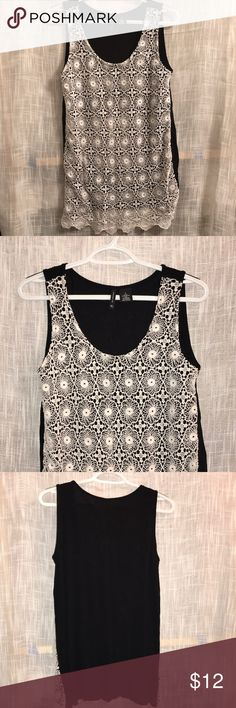 Sleeveless top Sleeveless crochet top. The back is a solid black and the front has a crochet white pattern. new directions Tops Blouses