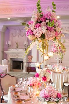 Variations of tall pink and green floral centerpieces at the Park Savoy in Florham Park, NJ