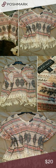 Poncho Fringe Western Cowgirl Aztec Top Size - L - Poncho type top sleeved with fringe. Aztec print......Burnt orange, tan, black with cream color fringe. Almost Famous Tops Blouses