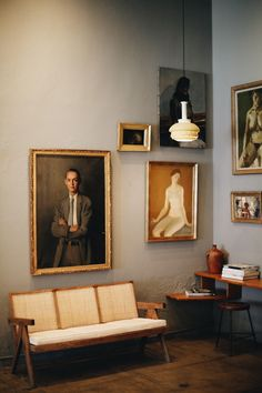 Portrait gallery -vintage painted portraits make interesting wall groupings