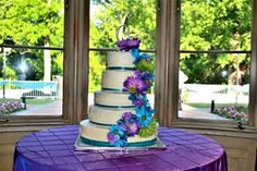 Turquoise purple flowers wedding cake.