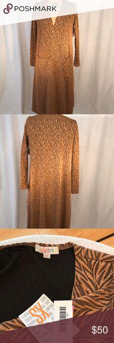 Sweater Beautiful Lularoe Sarah with coppery brown textured print over a black lining. 90% polyester and 4% spandex. Stretchy material. LuLaRoe Sweaters Shrugs & Ponchos
