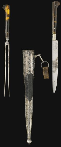 Ottoman knife and fork set (trousse), circa 1700-20, the steel knife and pronged fork mounted with tortoise shell plaques to the hilts, the wood scabbard with leather cover and silver-gilt mounts with nielloed decoration engraved with an arabesque of spiraling floral scrolls, with medallion inscribed to 'Huffenberg' with Arabic rendering, bud terminal and suspension loop with leather attachment Quantity: 3 21.5cm.