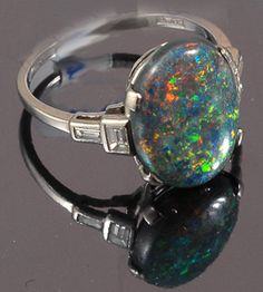 Platinum set Black Opal and diamond deco ring.  Finest black opal we have ever had with lots of colours spread evenly natural opal 1920c
