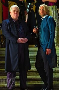 Phillip Seymour Hoffman and Woody Harrelson in 'Hunger Games: Catching Fire' (2013). Costume Designer: Trish Summerville