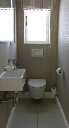 Small Bathroom Hand Basins ensuite, walnut basin looks good with grey tiles. tap at end good