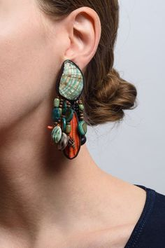 $925.00 | Monies UNIQUE Mixed Shells, Ebony, and Copper Earrings | Monies jewelry is bold in design and strong in aesthetic. These Monies earrings are made with Coral, Shells, Ebony, Copper, and Sterling Silver, to become a unique turquoise green and orange statement pair. All pieces are handmade. Monies is sold online and in-store at Santa Fe Dry Goods & Workshop in Santa Fe, New Mexico.