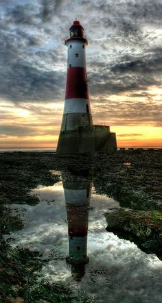 Lighthouse, sunset , water